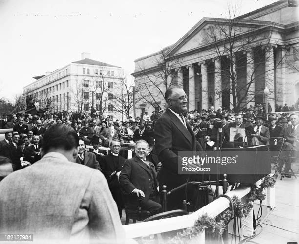 American politician US President Franklin D Roosevelt speaks at podium in Lafayette Square Washington DC April 1936 The DAR Constitution Hall is...