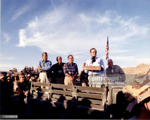 American politician US President George HW Bush speaks to United States military personnel before sharing the holiday meal, Saudi Arabia, November...