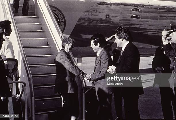 American politician US President Jimmy Carter steps off Air Force One and shakes hands with Massachusetts Governor Michael Dukakis Bedford...