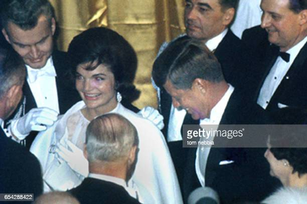American politician US President John F Kennedy and his wife First Lady Jacqueline Bouvier Kennedy share a laugh with guests at an inaugural ball at...