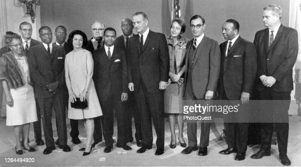 American politician US President Lyndon B Johnson and First Lady Lady Bird Johnson pose with members of the newly reorganized City of Washington...
