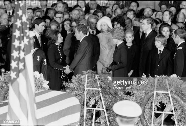 American politician US President Richard Nixon offers condolences to Lady Bird Johnson at the funeral of her husband, former President Lyndon B...