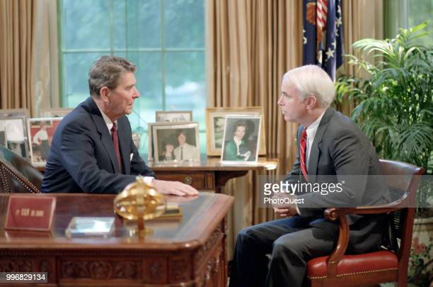 American politician US President Ronald Reagan meets with Senator John McCain in the White House's Oval Office Washington DC July 31 1986 The meeting...