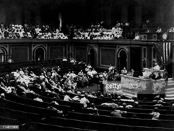American politician, US Representative Jeanette Rankin stands at the podium and speaks before Congress, Washington DC, May 1917. The first female...