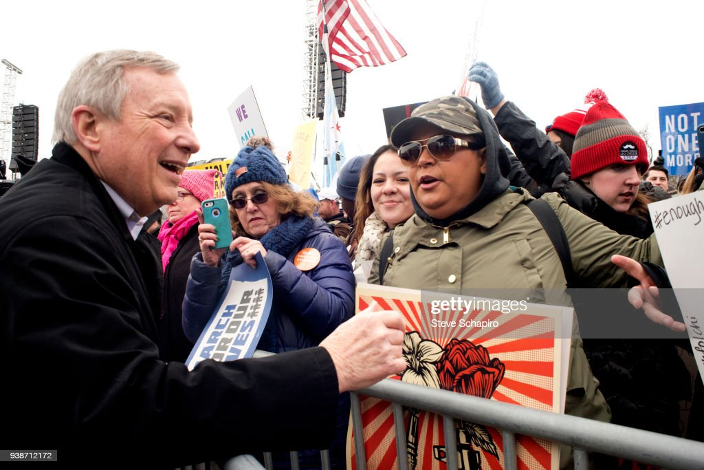 American politician US Senator Dick Durbin (left) poses with demonstrators behind a police barrier during the March For Our Lives rally, Chicago, Illinois, March 24, 2018.