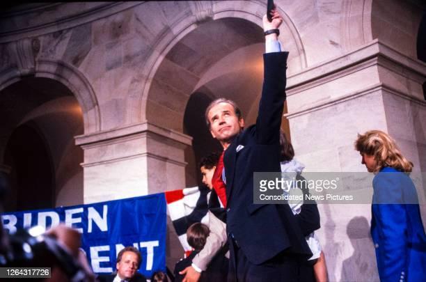 American politician US Senator Joseph Biden waves after announcing his intention to run for the 1988 Democratic presidential nomination, Washington...
