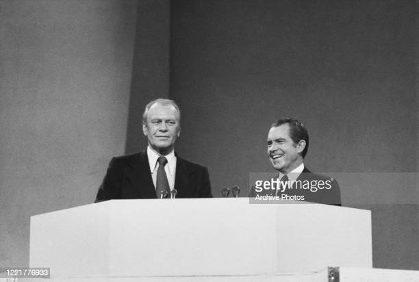 American politicians Gerald Ford and Richard Nixon , 37th president of the United States, take the stand at the Republican National Convention, at...