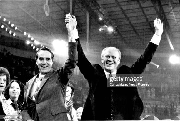 American politicians US Senator Bob Dole and US President Gerald Ford smile and raise their hands during Republican National Convention at the Kemper...