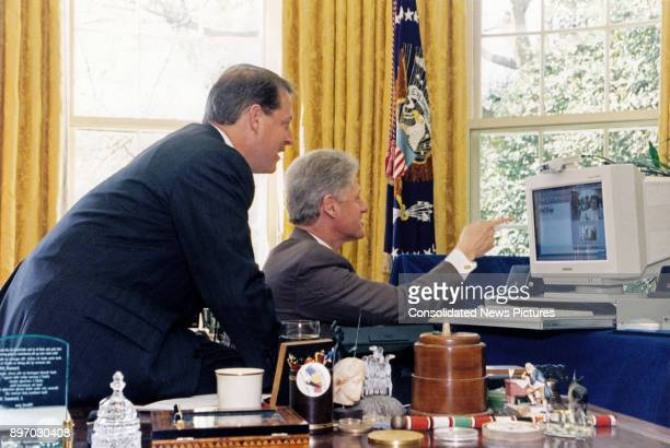 American politicians US Vice President Al Gore and US President Bill Clinton look a computer during their joint live radio address in the White...