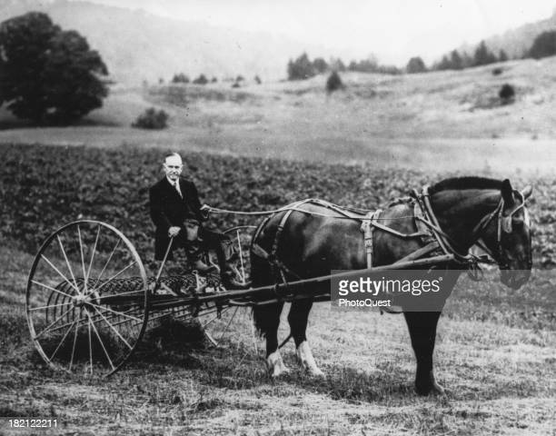 American poltician and former US President Calvin Coolidge plows a field on his farm, Plymouth, Vermont, early 1930s.