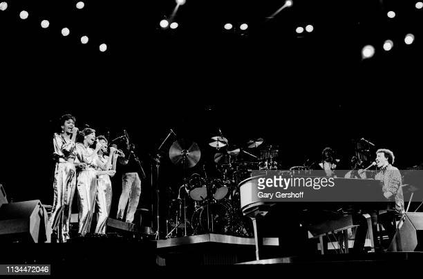 American Pop and RB group the Pointer Sisters perform eith musician Lionel Richie on piano as they performs onstage at Radio City Music Hall New York...