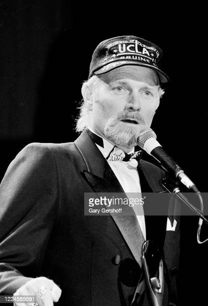 American Pop and Rock musician Mike Love speaks onstage during his induction, as a member of the group the Beach Boys, at the Rock and Roll Hall of...