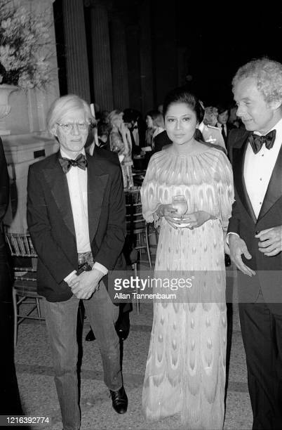 American Pop artist Andy Warhol and Filipino First Lady Imelda Marcos attend the Glory of Russian Costume Exhibition, held in the Metropolitan Museum...