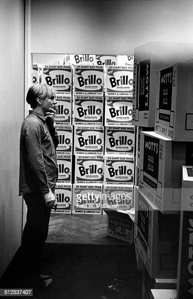 American pop artist Andy Warhol contemplates his towering product box sculptures in the Stable Gallery New York New York April 21 1964