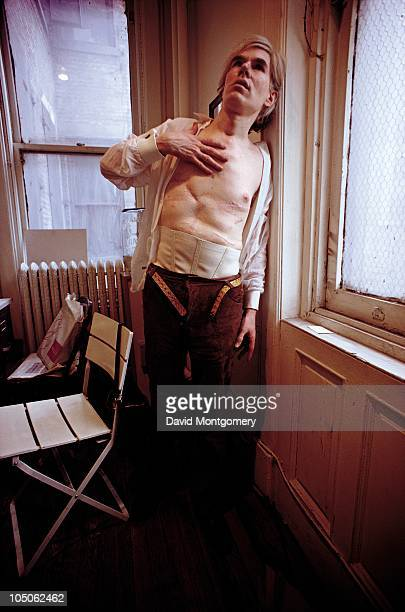 American pop artist Andy Warhol displays the scars on his torso which resulted from being shot in an attempted assassination by radical feminist...