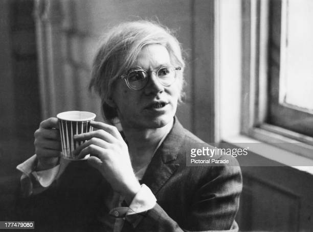 American pop artist Andy Warhol holding a paper cup, 9th August 1971.