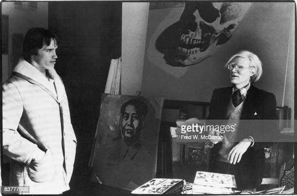 American pop artist Andy Warhol meets with Austrianborn American bodybuilder Arnold Schwarzenegger at Warhol's Studio the Factory New York New York...