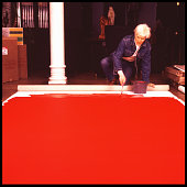 American pop artist andy warhol paints a red canvas on the floor of picture id518543166?s=170x170
