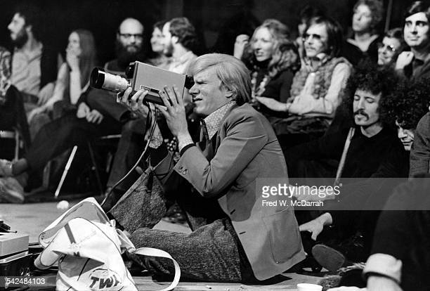 American pop artist Andy Warhol uses a video camera during a during the taping of an episode of the television program 'The David Susskind Show'...
