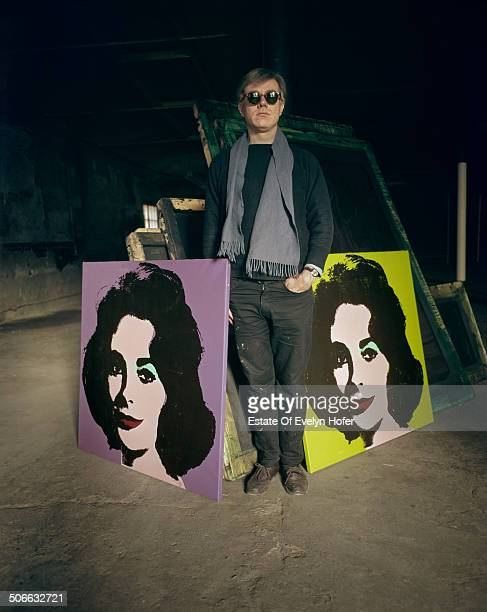 American pop artist Andy Warhol with two prints of actress Elizabeth Taylor New York 1964
