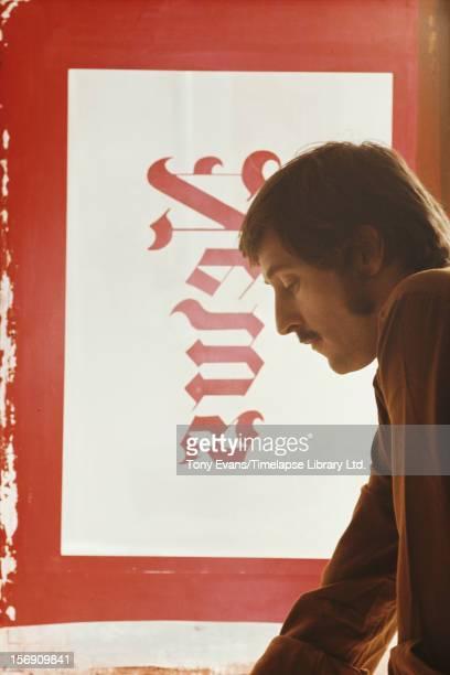 American pop artist Ed Ruscha with his mixed-media lithograph 'News', circa 1970.