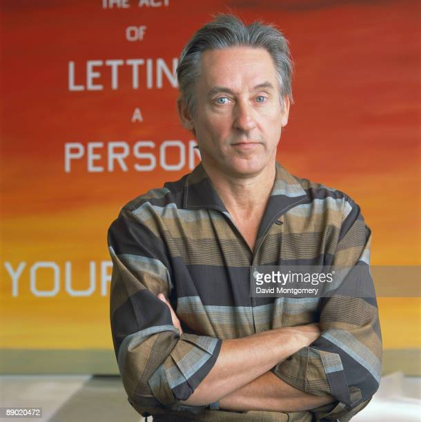 American pop artist Edward Ruscha with his 1983 work 'The Act of Letting a Person into Your Home', 14th December 1990.