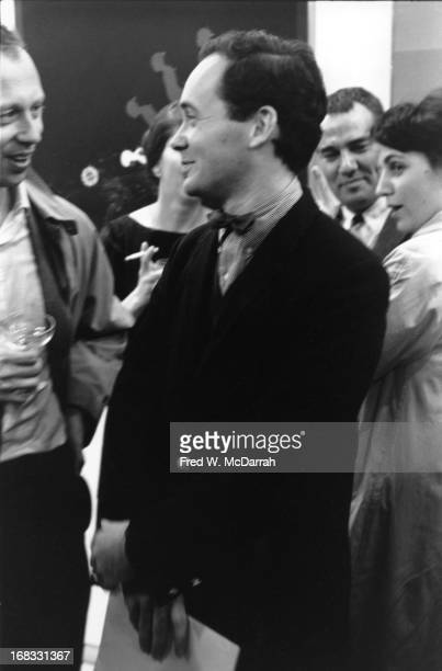 American Pop artist Robert Indiana listens to fellow artist Ellsworth Kelly at a unspecified event New York New York October 29 1963
