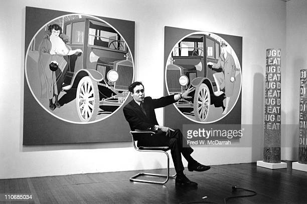 American Pop artist Robert Indiana sits in a chair and speaks in front of his diptych painting entitled 'A Mother Is a Mother and A Father Is a...