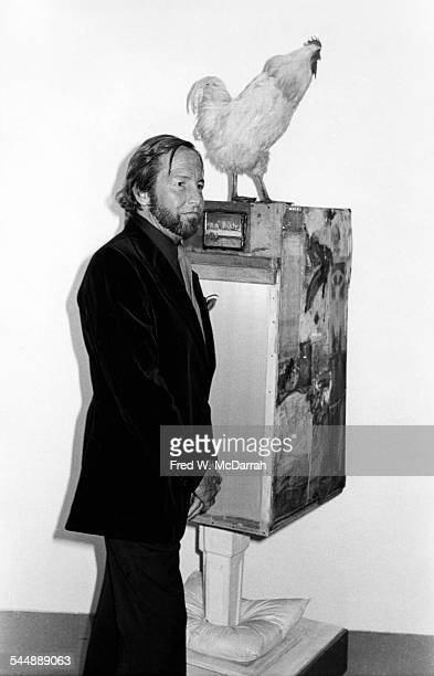 American Pop artist Robert Rauschenberg poses beside one of his works at a MOMA exhibit New York New York March 23 1977