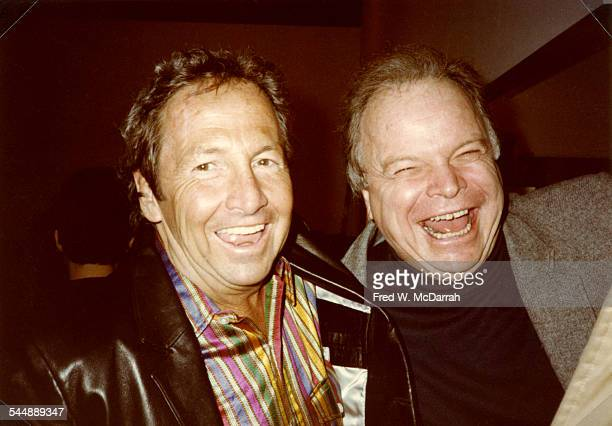 American Pop artist Robert Rauschenberg shares a laugh with photographer Bob Adelman as they atttend an opening of Rauschenberg's works at the Leo...