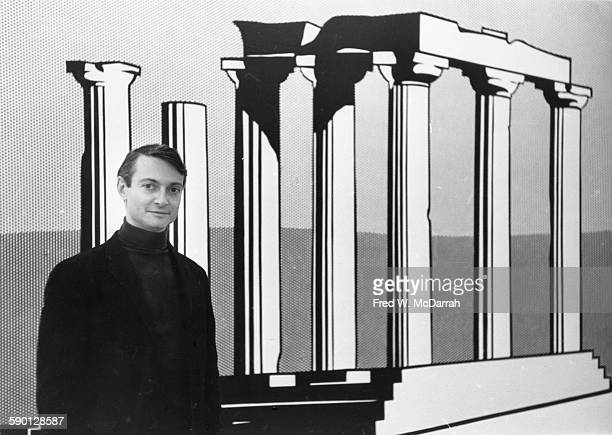 American Pop artist Roy Lichtenstein poses in front of his work 'Temple of Apollo' at the Leo Castelli Gallery New York New York October 24 1964