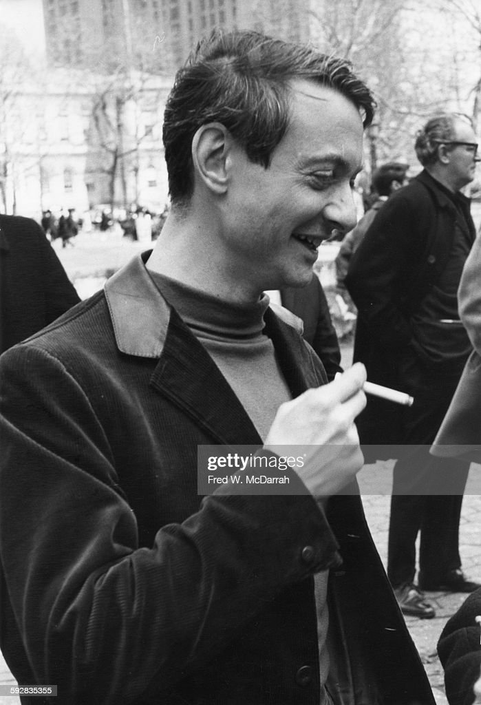 American Pop artist Roy Lichtenstein (1923 - 1997) smokes a cigarette as he attends the March on City Hall to Save Artists Lofts, New York, New York, April 3, 1964.