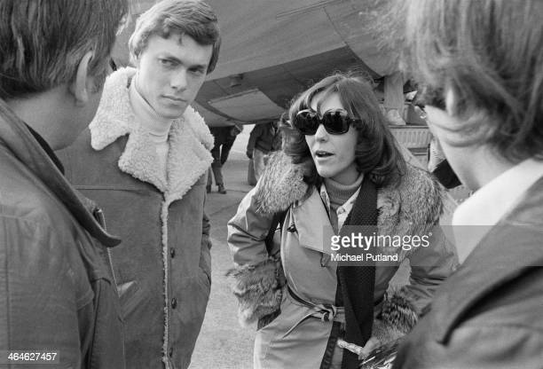 American pop duo The Carpenters Karen Carpenter and her brother Richard at an airport during a European tour February 1974