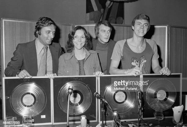 American pop duo The Carpenters Karen Carpenter and her brother Richard with awards for sales of their album 'Now Then' and their compilation 'The...