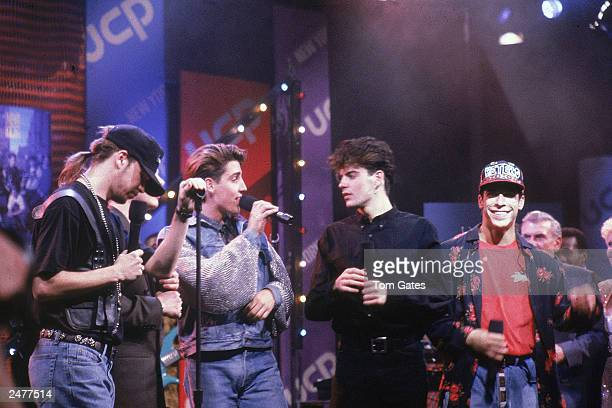 American pop group New Kids on the Block perform on a television show circa 1990