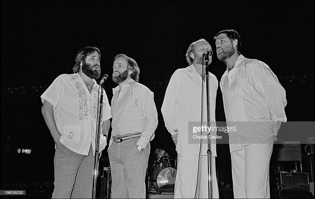 American pop group The Beach Boys rehearse for a performance at the CBS Convention at the Dorchester Hotel, London, 30th July 1977. Left to right: Carl Wilson, Al Jardine, Mike Love and Brian Wilson.
