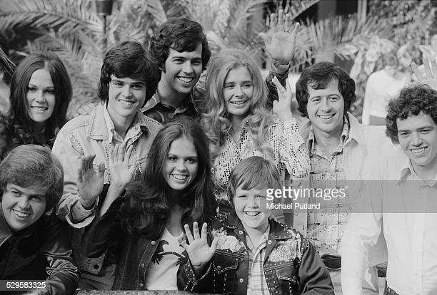 American pop group The Osmonds at a press conference UK 11th August 1974 Back row left to right unidentified Donny Alan unidentified Wayne and Jay...