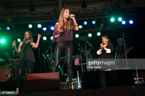 American Pop group Wilson Phillips performs onstage at the Interlochen Center For the Arts Interlochen Michigan July 23 2013 Pictured are Chynna...