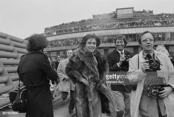 American pop idol David Cassidy is greeted by thousands of fans upon his arrival at Heathrow Airport UK 24th March 1973 He is surrounded by...