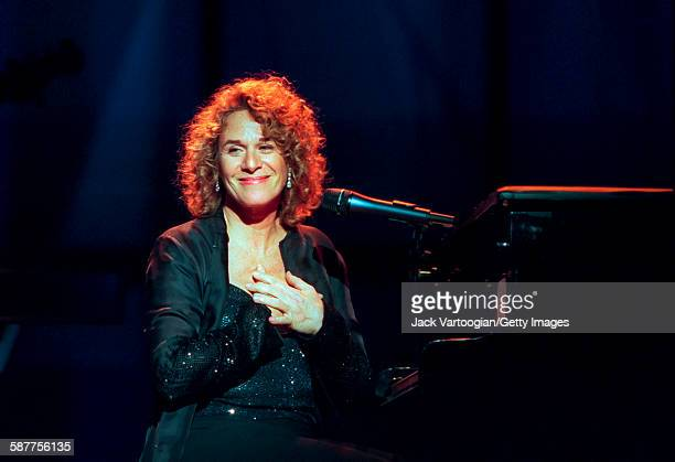 American Pop musician Carole King sits at the piano as she performs in the Theater at Madison Square Garden during People Magazine's 25th Anniversary...
