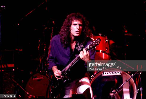 American pop musician Michael Bolton plays guitar on stage, Chicago, Illinois, July 9, 1983.
