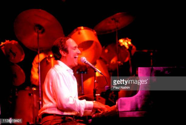 American Pop musician Neil Sedaka plays piano as he performs onstage at the Park West Chicago Illinois November 25 1978