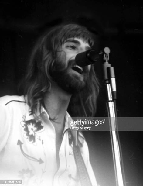 American Pop Rock and Folk musician Kenny Loggins plays guitar as he performs on stage with his group Loggins and Messina Monterey California early...