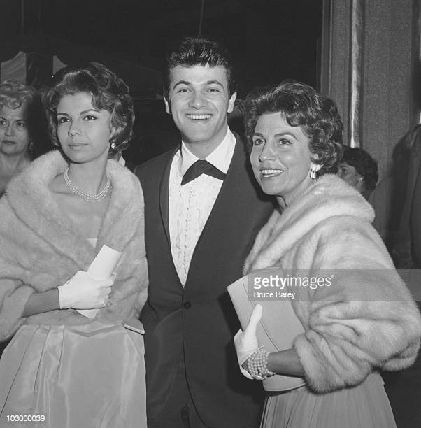 American pop singer and actor Nancy Sinatra American pop singer Tommy Sands and Nancy Sinatra Sr pose together at the premiere of 'CanCan' at the...