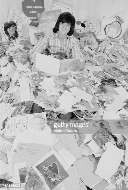 American pop singer Donny Osmond with some of his fan mail and Valentine's cards 2nd March 1973