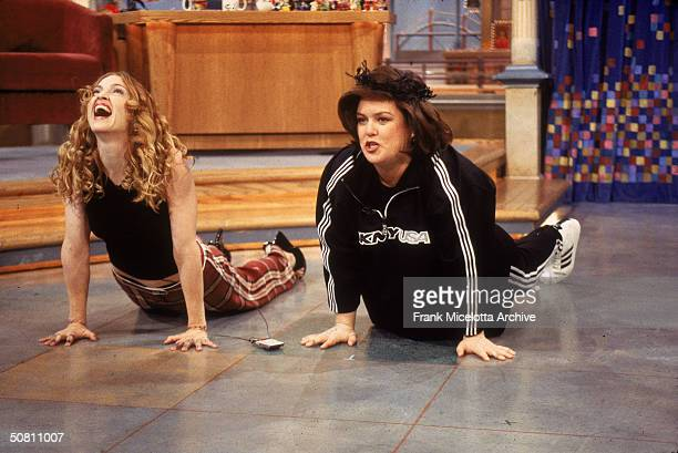 American pop singer Madonna and television show host and actress Rosie O'Donnell excercise together on an epsiode of 'The Rosie O'Donnell Show' New...