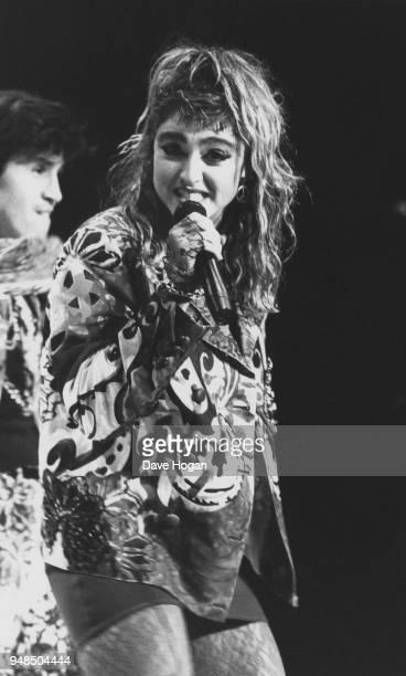 American pop singer Madonna performing on stage, 1985.