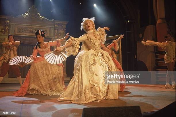 American pop singer Madonna performs her single 'Vogue' with a group of dancers on the '1990 MTV Video Music Awards' show New York New York September...