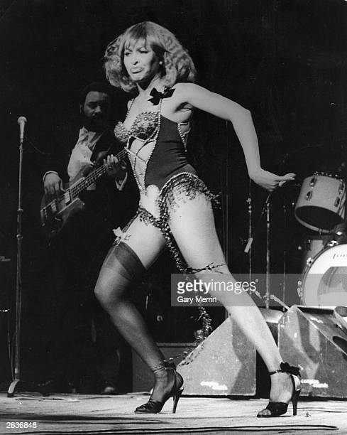 American pop singer Tina Turner performing on stage at the Hammersmith Odeon her first solo concert in London since splitting up with her partner Ike...