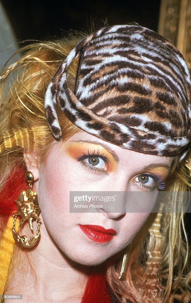 American pop singer Cyndi Lauper wearing a leopard print hat during the presentation of her gold record for her album, 'She�s So Unusual', Austria, 1986.